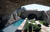 The modern lap-pool in the sun-filled courtyard was fashioned out of old local stone so as to blend with its surroundings