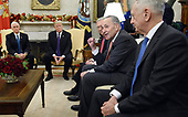 United States Senate Minority Leader Charles Schumer (Democrat of New York) speaks during a meeting between US President Donald J. Trump and bipartisan Congressional leadership in the Oval Office of the White House , December 7, 2017 in Washington, DC.  From left to right US Vice President Mike Pence, President Trump, US Senate Majority Leader Mitch McConnell (Republican of Kentucky), Leader Schumer, and US Secretary of Defense Jim Mattis.<br /> Credit: Olivier Douliery / Pool via CNP