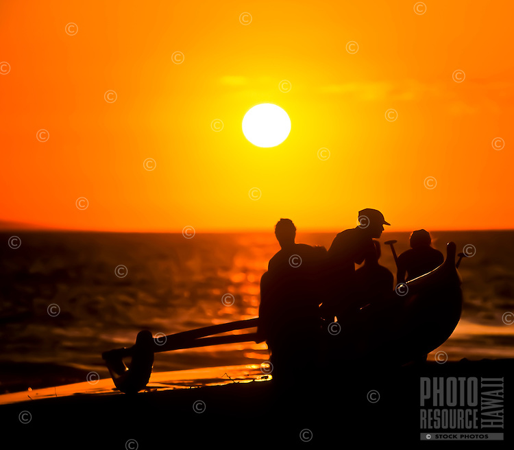 At sunset, women paddlers finish up for the day at Ka'anapali Beach, Maui.