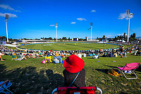 Fans watch from the embankment on day one of the international cricket 1st test match between NZ Black Caps and England at Bay Oval in Mount Maunganui, New Zealand on Thursday, 21 November 2019. Photo: Dave Lintott / lintottphoto.co.nz