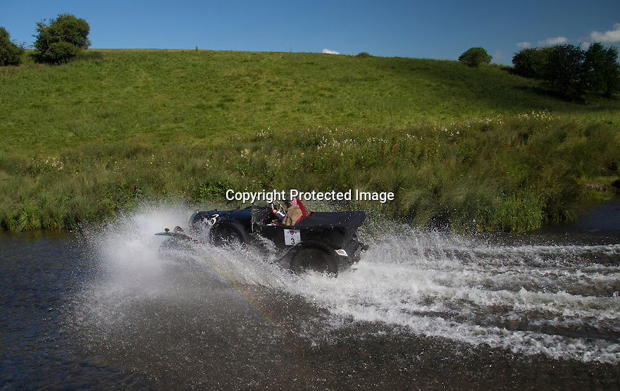 14/06/16<br /> <br /> Graham and Marina Goodwin in a 1925 Bentley Super Sports.<br /> <br /> Competitors in the Royal Automobile Club 1000 Mile Trial splash through Tissington Ford near Ashbourne in the Derbyshire Peak District. The rally saw 43 pre-war cars leave Edinburgh on Monday and finishes in Dorking, Surrey on Saturday.<br /> All Rights Reserved, F Stop Press Ltd.