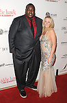 Quinton Aaron and Cindy Rocker arriving at the 11th Annual Living Legends of Aviation Awards, held at The Beverly Hilton Hotel