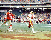 Washington, D.C. - January 8, 1984 -- Washington Redskins wide receiver Charlie Brown (87) scores after catching a 70 yard touchdown pass from quarterback Joe Theismann (7) late in the third quarter in the NFC Championship game at RFK Stadium in Washington, D.C. on Sunday, January 8, 1984.  The Redskins won the game 24 - 21 to go to Super Bowl XVIII..Credit: Arnie Sachs / CNP