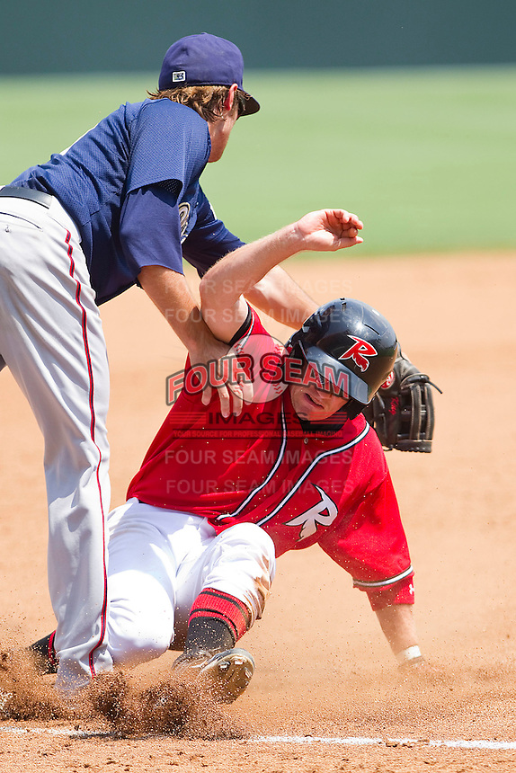 Skyler Stromsmoe #1 of the Richmond Flying Squirrels slides into third base under the tag attempt by Stephen King #16 of the Harrisburg Senators during the Eastern League game against the Harrisburg Senators at The Diamond on July 22, 2011 in Richmond, Virginia.  The Squirrels defeated the Senators 5-1.   (Brian Westerholt / Four Seam Images)