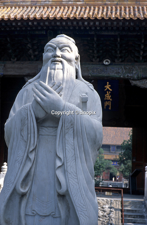 A Confucius statue stands in the Confucius Temple, Beijing, China..25 Jul 2005