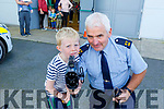 Little Luke Kelliher from Listowel helping Gda Seamus Moriarty with the Speed Gun at the Little Heros Fun day event by Recovery Haven in the John Mitchels Complex on Sunday