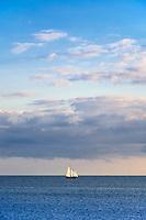 Sailboat at full sail on a pristine ocean, Cape Cod, MA, USA