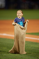 A young fan takes part in a sack race during a Charlotte Stone Crabs game against the Palm Beach Cardinals on April 11, 2017 at Charlotte Sports Park in Port Charlotte, Florida.  Palm Beach defeated Charlotte 12-6.  (Mike Janes/Four Seam Images)