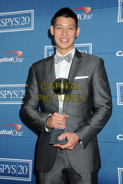 Jeremy Lin.2012 ESPY Awards - press room held at Nokia Theatre L.A. Live, Los Angeles, California, USA..11th July 2012 .half length suit award trophy winner white shirt bow tie check.CAP/ADM/BP.©Byron Purvis/AdMedia/Capital Pictures.