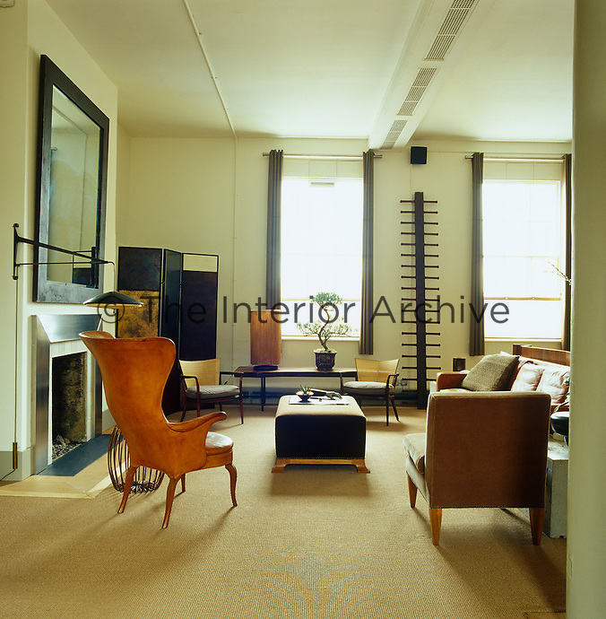 Light floods into the living area from the large Victorian windows of the apartment