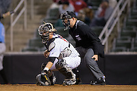 Kannapolis Intimidators catcher Casey Schroeder (10) reaches for a low pitch as home plate umpire Ryan Powers looks on during the game against the Hickory Crawdads at Kannapolis Intimidators Stadium on April 9, 2016 in Kannapolis, North Carolina.  The Crawdads defeated the Intimidators 6-1 in 10 innings.  (Brian Westerholt/Four Seam Images)