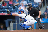 Durham Bulls catcher Luke Maile (26) sets a target as home plate umpire Carlos Torres looks on during the game against the Scranton/Wilkes-Barre RailRiders at Durham Bulls Athletic Park on May 15, 2015 in Durham, North Carolina.  The RailRiders defeated the Bulls 8-4 in 11 innings.  (Brian Westerholt/Four Seam Images)