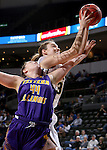 SIOUX FALLS, SD - MARCH 6:  Blair Bryce #30 of Oral Roberts shoots over Sophie Reichelt #44 of Western Illinois in the 2016 Summit League Tournament. (Photo by Dave Eggen/Inertia)