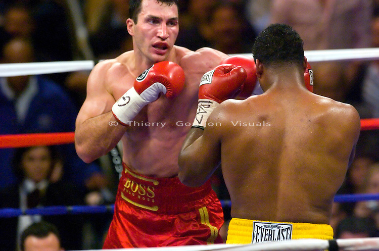 Wladimir Klitschko (l) on the attack against Calvin Brock during their  IBF/IBO Heavyweight Championship at Madison Square Garden  in NYC on 11.11.06..Klitschko won by a 7th  round KO.<br />