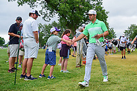 Paul Casey (GBR) shakes hands with a young fan on his way to the 11th tee during round 4 of the Dean &amp; Deluca Invitational, at The Colonial, Ft. Worth, Texas, USA. 5/28/2017.<br /> Picture: Golffile | Ken Murray<br /> <br /> <br /> All photo usage must carry mandatory copyright credit (&copy; Golffile | Ken Murray)