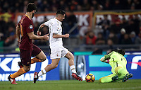Calcio, Serie A: Roma vs Milan. Roma, stadio Olimpico, 12 dicembre 2016.<br /> Milan's Gianluca Lapadula, center, chased by Roma&rsquo;s Federico Fazio, is fouled by goalkeeper Wojciech Szczesny during the Italian Serie A football match between Roma and AC Milan at Rome's Olympic stadium, 12 December 2016.<br /> UPDATE IMAGES PRESS/Isabella Bonotto