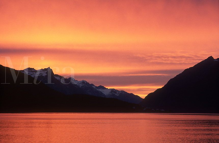 The sky and the waters of Lynn Canal glow after sunset near Haines, Alaska.