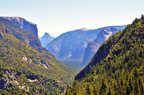 Tunnel View scenic overlook is a historic site, located adjacent to Wawona Road, affording expansive views of Yosemite Valley, El Capitan, Bridalveil Falls, and Half Dome.