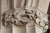 Carved capital with vine leaves and grapes, possibly 15th century, in the transept of the Collegiate Church of Saint-Gervais-Saint-Protais, built 12th to 16th centuries in Gothic and Renaissance styles, in Gisors, Eure, Haute-Normandie, France. The church was consecrated in 1119 by Calixtus II but the nave was rebuilt from 1160 after a fire. The church was listed as a historic monument in 1840. Picture by Manuel Cohen