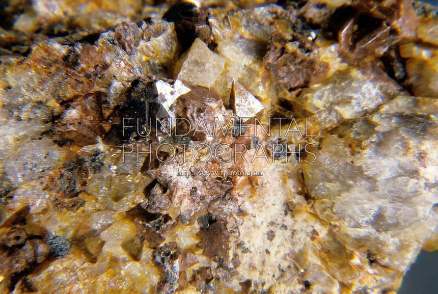 ZIRCON<br /> Zirconium Silicate <br /> Nesosilicate Subclass<br /> ZrSiO4: Popular gemstone and important ore of Zirconium &amp; Hafnium &amp; Thorium; tetragonal-ditetragonal bipyramidal<br />  Dark brown color from iron oxide impurities.