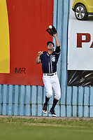 Asheville Tourists right fielder David Dahl #21 makes a play against the wall during a game against the Rome Braves at McCormick Field on May 1, 2014 in Asheville, North Carolina. The Tourists defeated the Braves 8-7. (Tony Farlow/Four Seam Images)