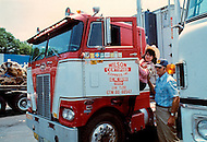 Nashville, Tennessee - June 10, 1977. This photograph was taken of Yvette Horner  with a truckdriver, when she visited Nashville, Tennessee to play at the Ole Opry. Yvette Horner (born September 22nd, 1922) is a renown French accordionist, whose career has spanned over 70 years, has given thousands of concerts around the world and sold over 30 million records.