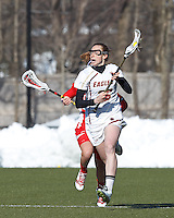 Boston College defender Claire Blohm (26) brings the ball forward..Boston College (white) defeated Boston University (red), 12-9, on the Newton Campus Lacrosse Field at Boston College, on March 20, 2013.