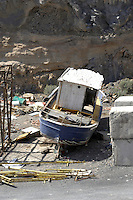 Old wrecked boat on abandoned building site.Tenerife, canary islands