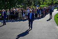 United States President Donald J. Trump walks towards the media to make remarks and answer questions as he departs the South Lawn of the White House in Washington, DC for a day of activities in San Antonio, Texas and Houston, Texas on April 10, 2019.<br /> Credit: Ron Sachs / CNP/AdMedia