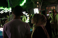 June 12, 2014 - Tehran (Iran). A young couple passes by a light decoration placed to celebrate the birthday of Imam Mahdi in a neighborhood in the south of Tehran. © Thomas Cristofoletti / Ruom