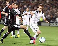 Santino Quaranta (25) of D.C. United tries to get the ball from Mike Magee (18) of the Los Angeles Galaxy during an MLS match at RFK Stadium, on April 9 2011, in Washington D.C.The game ended in a 1-1 tie.