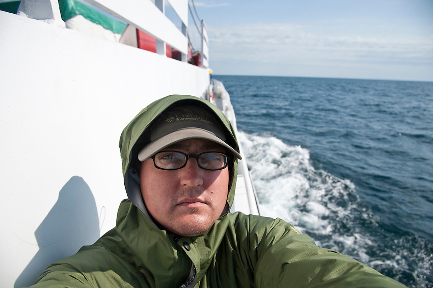 Writer and photographer Aaron Peterson aboard the Isle Royale Queen ferry ship to Isle Royale National Park on Lake Superior.