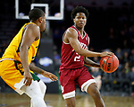 SIOUX FALLS, SD - MARCH 7: Roscoe Eastmond #2 of the Denver Pioneers looks to pass the ball around Vinnie Shahid #0 of the North Dakota State Bison at the 2020 Summit League Basketball Championship in Sioux Falls, SD. (Photo by Richard Carlson/Inertia)