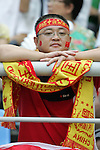 10 August 2008: Unidentified China fan.  China played in the second game of the night against Belgium.  The men's Olympic soccer team of Belgium defeated the men's Olympic soccer team of China 2-0 at Shenyang Olympic Sports Center Wulihe Stadium in Shenyang, China in a Group C round-robin match in the Men's Olympic Football competition.
