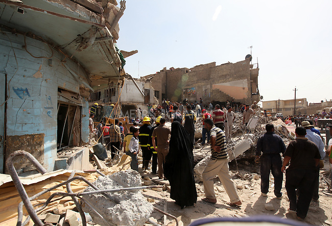 BAGHDAD, IRAQ: Men sort through the rubble after a bomb explosion in the Alawi neighborhood, a Shia area in Baghdad...Bombs destroyed seven buildings in three areas of the Iraqi capital Baghdad, killing at least 28 people and wounding 75...photo by Seerwan Aziz