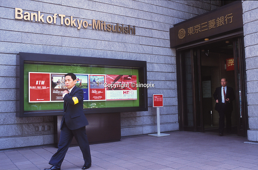 Businessmen walk out from the Bank of Tokyo-Mitsubishi.