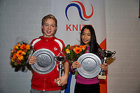 November 30, 2014, Almere, Tennis, Winter Youth Circuit, WJC,  Prizegiving, Overall winners girls and boys 14 years, Lian Tran and Lodewijk Westraten<br /> Photo: Henk Koster