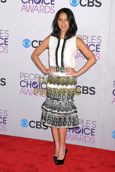 Olivia Munn.People's Choice Awards 2013 - Arrivals held at Nokia Theatre L.A. Live, Los Angeles, California, USA..January 9th, 2013.full length black lace white skirt top sleeveless hands on hips.CAP/ADM/BP.©Byron Purvis/AdMedia/Capital Pictures.