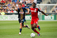 Antoine Hoppenot (29) of the Philadelphia Union battles for the ball with  Doneil Henry (4) of Toronto FC. The Philadelphia Union defeated Toronto FC 3-0 during a Major League Soccer (MLS) match at PPL Park in Chester, PA, on July 8, 2012.