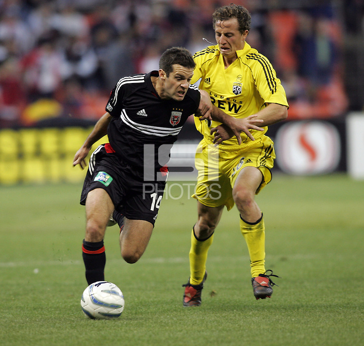 7 May 2005.  DC United's Ben Olsen (14) fights for the ball with Domenic Mediate (28) of the Columbus Crew at RFK Stadium in Washington, DC.