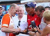 June 17th 2017, Gander Green Lane, Sutton, England; Football Charity Match; Chelsea Legends versus Rangers Legends; Rangers player Gordon Durie signs autographs before kick off