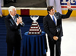 24 September 2009: Montreal Canadiens' all-time great Jean Beliveau (left) awards Patrice Brisebois the Jean Beliveau Trophy for his charitable work in the Montreal community. Brisebois announced his career had come to an end after 18 seasons - 16 with the Canadiens. The ceremony took place prior to a game at the Bell Centre in Montreal, Quebec, Canada, where the Boston Bruins edged out the Canadiens 2-1in a pre-season overtime shootout. Mandatory Credit: Ed Wolfstein Photo