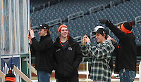 Members of the Omaha Lancers enjoy the atmosphere of the outdoor ice rink prior to practice at TD Ameritrade Park in Omaha, Neb., Thursday, Feb. 7, 2013. (Photo by Michelle Bishop)