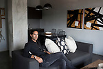 MABONENG, SOUTH AFRICA - MARCH 22: Property developer Jonathan Liebmann sits in a show apartment in one of his newest projects, Hallmark House in Maboneng district on March 22, 2016 in downtown Johannesburg, South Africa. The building is the idea of Mr. Liebmann and celebrated architect David Adjaye. Maboneng is mostly owned and controlled by Mr. Liebmann. A former derelict industrial area, and a no-go area after dark, Maboneng is now a vibrant area with artists, businesses, galleries and tourists. A racially mixed cultural hub with markets on the weekend. (Photo by Per-Anders Pettersson/Getty Images)