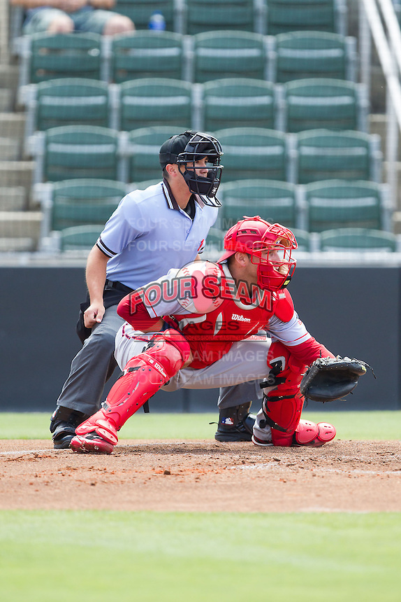 Hagerstown Suns catcher Spencer Kieboom (20) sets a target as home plate umpire Derek Gonzales looks on during the game against the Kannapolis Intimidators at CMC-Northeast Stadium on June 1, 2014 in Kannapolis, North Carolina.  The Intimidators defeated the Suns 5-1 in game one of a double-header.  (Brian Westerholt/Four Seam Images)