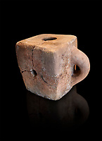 Hittite terra cotta cube shaped libation vessel. Hittite Empire, Alaca Hoyuk, 1450 - 1200 BC. Alaca Hoyuk. Çorum Archaeological Museum, Corum, Turkey. Against a black bacground.