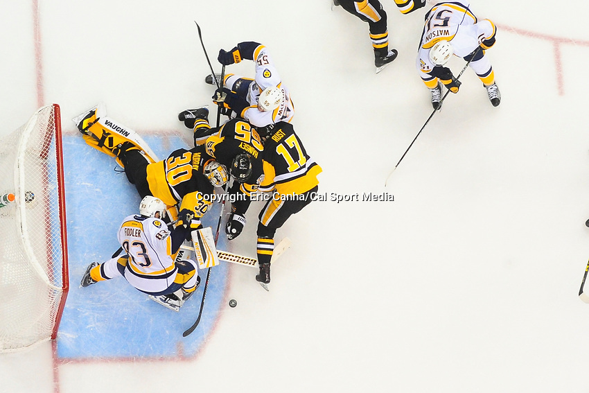 May 29, 2017: Pittsburgh Penguins goalie Matt Murray (30)battles with Nashville Predators center Vernon Fiddler (83) to keep the puck put of the net during game one of the National Hockey League Stanley Cup Finals between the Nashville Predators  and the Pittsburgh Penguins, held at PPG Paints Arena, in Pittsburgh, PA. Pittsburgh defeats Nashville 5-3 in regulation time.  Eric Canha/CSM