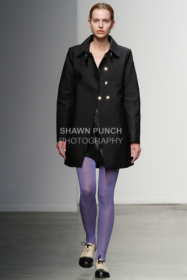 Model walks runway in a in legwear from the Tightology Fall 2014 collection, at Fashion Palette New York Fall Winter 2014/2015; during New York Fashion Week Fall 2014, on February 11, 2014.