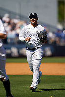 New York Yankees Gleyber Torres (25) jogs to the dugout during a Spring Training game against the Toronto Blue Jays on February 22, 2020 at the George M. Steinbrenner Field in Tampa, Florida.  (Mike Janes/Four Seam Images)
