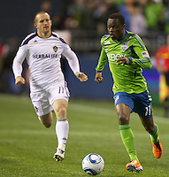 Seattle Sounders FC forward Steve Zakuani dribbles the ball up field in front of L.A. Galaxy forward Chad Barrett during play at Qwest Field in Seattle Tuesday March 15, 2011. The Galaxy won the game 1-0.
